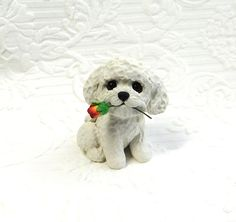 Bichon Frise lover Gift, Bichon art, Bichon Frise Sculpture Polymer Clay with Rose Mini by Raquel at theWRC clay DOG Collectible. Bichon Frise lover Gift, Bichon art, Bichon Frise Sculpture Polymer Clay with Rose Mini by Raquel at theWRC clay DOG Collectible This little pup looks so cute holding a a rose in it's mouth for someone special! Hand sculpted polymer clay dog. Made with love and care! Measures approx. 2.25 inches tall.
