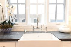 Durable kitchen countertop. Soapstone is a durable countertop ideal for kitchen islands and perimeter cabinets. #Durable #Countertop #Soapstone Graystone Custom Builders.