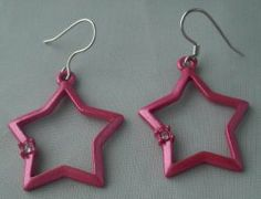 Hot Pink Star Figural French Hook Pierced Earrings. Pierced earrings are hot pink stars with a small clear stone on one side and open centers. French hook style.