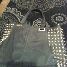 Cute black tote with gold studds Black purse with golden studds on each side, satin leopard lining inside!! Adorable!! Pretty big lional Bags Totes