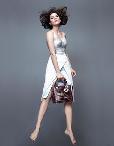 Who What Wear Blog Marion Cotillard Lady Dior FW 2014 Campaign Photographer Jean-Baptiste Mondino Jumping Ladylike Photos Silver White Sleeveless Dress Burgundy Pantent Croc-Embossed Bag Barefoot