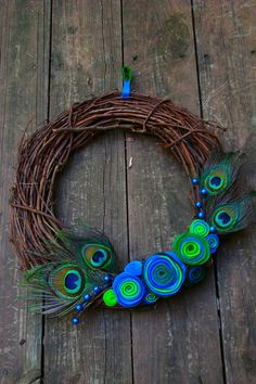 Peacock Wreath - cute idea minus the weird felt 'roses' - maybe burgundy or purple silk peonies Peacock Wreath, Peacock Crafts, Peacock Decor, Peacock Colors, Peacock Art, Peacock Theme, Peacock Feathers, Green Peacock, Feather Wreath