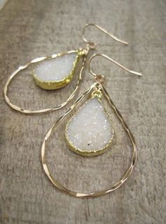 MORE COLORS!  Glittering natural jasper quartz druzy drops dance from within hammered 14K gold fill hoops to create these beautiful statement earrings. These stones are absolutely gorgeous! They are 100% natural, meaning they have not been dyed, treated or enhanced in any way. Each teardrop shaped druzy is framed in gold leaf for a polished finish - the backs are left natural to allow light to pass through. They dangle from within hammered 14K gold fill hoops.