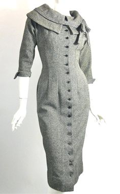 50s wool tweed black and grey button up wiggle dress with rounded collar accented with a bow. Peaked cuffs. No flaws. By Junior Sophisticates.