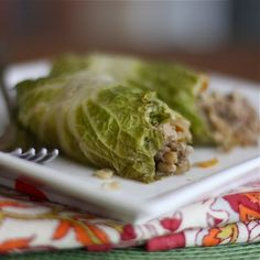 Asian Stuffed Napa Cabbage Rolls - 1 lb. lean ground beef - carrots - brown rice or quinoa - 5 garlic cloves - minced ginger - onion - low sodium soy sauce - toasted sesame oil - rice vinegar - chili or chili garlic sauce - leaves from large Napa cabbage