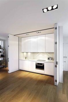 A concealed white kitchen byBoffi.