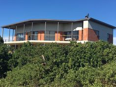 Paradise Beach - Jeffreys Bay - R2 900 000 - Modern-meets-Nature! - Contemporary-modern-meets-Nature with this beautiful architectural marvel! The property owner built to capture the natural surrounds and become one with the environment! Throughout this home light flows in through large room height folding doors and windows enjoying endless views of mountains and ocean! Multiplying the feel of space of this 500sqm sized property in Paradise! Ground floor: Beautiful indigenous garden… Folding Doors, Ground Floor, Modern Contemporary, Property For Sale, South Africa, Cape, Paradise, Environment, Ocean