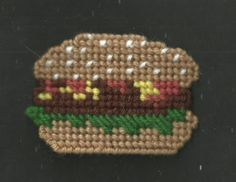 HAMBURGER WITH FIXINGS ON A SESAME SEED BUN FRIG. MAGNET