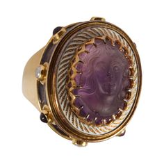 Elizabeth Gage Gold and Amethyst Cameo Ring. Via the-maac.com