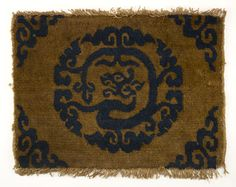 Wool pile carpet with a stylized dragon medallion | 1644-1911 | Qing dynasty | Fabric | China | Gift of Charles Lang Freer | Freer Gallery of Art | F1913.187