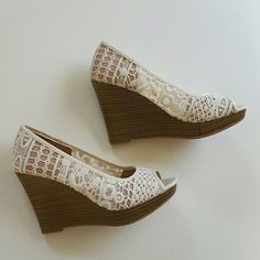 NWOT lace wedges cream color These are wonderful cream colored lace floral pattern, high heeled wedges with a brown and tan heel, the back of the heel has a stretchy band to help hold the shoe on even if they are a little to big. NWOT American Eagle by Payless Shoes