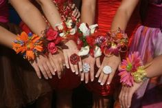 A prom corsage is an accessory just like jewelry, shoes, purses, etc. Why would you want a boring, red-rose-and-babys-breath corsage when you're prom dress is super-fab psychedelic colors? (Which they were. The biggest trend in prom dresses was bright, bold colors!) Fashion savvy girls have really gotten involved with their own prom corsages by attending corsage bar parties.