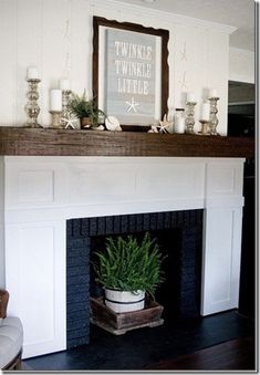Decorating an empty fireplace....love the basket and crates ...