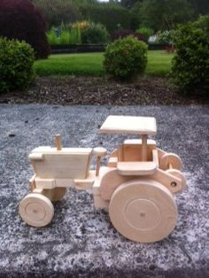 Awesome farm tractor made of pine. Perfect for the little ones or the young at heart.    Demensions: 12 1/2 x 8 1/2 x6 3/8