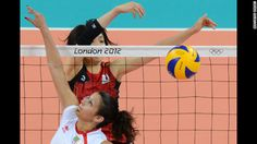 Algeria's Sehryne Hennaoui spikes the ball as Japan's Yukiko Ebata reaches to block during a women's volleyball match on Saturday.