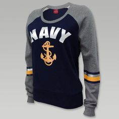 "Look radiant in the Navy Womens Anchor Scoop Neck a great lightweight sweatshirt. &nbsp  80% Cotton/ 20% Polyester True to size womens fit Silver screen print ""Navy"" letter design Yellow screen print anchor with clear sequin design Screen print stripes on sleeves Ribbed stretch waistband and cuffs HAND WASH ONLY"