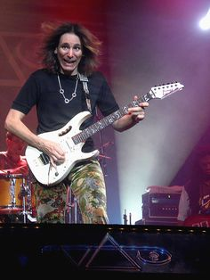 """Steve Vai - """"Oh really? Is THAT what they say about the faces I make on stage?"""" - IWTO"""