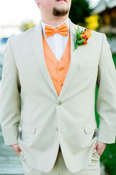 Groom wears a tan linen suit and orange bowtie at Harbour View in Northern VA | Megan Kelsey Photography