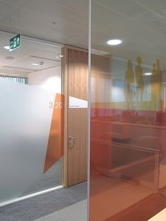 Graphic film on glass: Great use of transparent film to slightly diffuse the light.