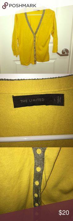 The Limited sweater Cute mustard yellow sweater with shimmering accent material down buttons. 3/4 sleeve that looks great with skinny jeans and flats with a tank top and chunk necklace! Some wrinkles but in great condition! Smoke free home The Limited Sweaters V-Necks