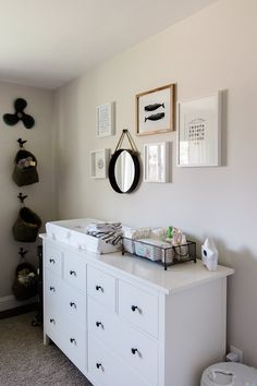 Finally starting to share some nurseries with you all. Today's nursery features a nod to nautical nursery and we just love the uniqueness of this room!