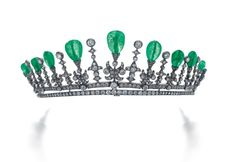 A striking diamond and emerald tiara, circa 1905. Featuring nine pear-shaped emeralds, possibly Columbian, on floral diamond pinnacles, with ten smaller spacers, each topped with a circular diamond; supported by a double row of diamonds as a base. Sold via Sotheby's on 12 May 2015, for CHF52,500.