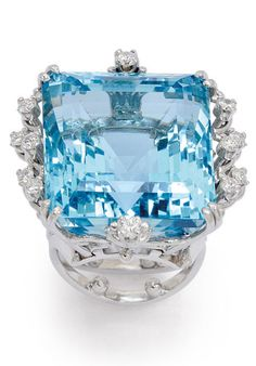 An Aquamarine and Diamond Ring  Featuring a square aquamarine weighing approximately 50.00 carats within scalloped wirework embellished by round diamonds, to the deep gallery with elaborate scrolling wirework and bifurcated band in platinum, size 4 with sizing beads