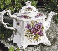 Traditional china teapot for serving. My Mom has this pot and now I use it in memory of all the love and laughter