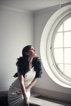 modern bride with black feather stole for WellWed Magazine; photography by @Carla TenEyck styling by @Beth Chapman