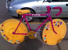 Bright and Spunky Pink and Yellow Yarn Bombed Bike