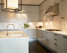 clean, contemporary kitchen | grey cabinetry + warm walnut