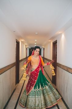 Mustard , red and green bridal lehenga  , emerald green bridal lehenga , silk bridal lehenga , twirling bride
