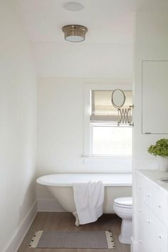 Designer James Huniford transforms a 1910 farmhouse into a contemporary home that's at once intimate and inviting. Love this simple and elegant all-white bathroom.