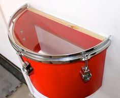 Small drums secured to wall as shelves - Decoist