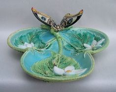 For bid is a beautiful Majolica pottery tray by George Jones. I think this is a very rare piece! The dish is trefoil-shaped, having three lobes. The tray is designed to look as if a branch has been c