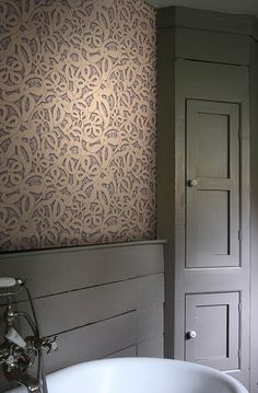 Vivienne Westwood designed wallpaper depicting lace in sand and greige