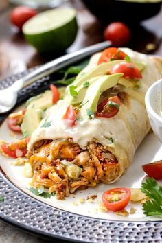 """Shredded Chicken Burritos AKA """"skinny chimichangas"""" are better than any restaurant without all the calories! made super easy by stuffing with the BEST slow cooker Mexican chicken and then baked to golden perfection and smothered in most incredible cheesy cream sauce."""