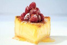 Deep lemon tart, raspberries and citrus syrup