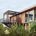 On a sandy cul-de-sac in Stinson Beach, California, architects Matthew Peek and Renata Ancona built an elevated modern structure beside a modest 1940s bungalow.