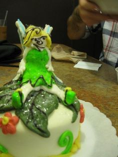 "Another hilarious ""Tinker Bell ""cake FAIL!  OH WAIT! IS THIS THE NEW CRACK WHORE VERSION? AH, YOU NAILED IT!"