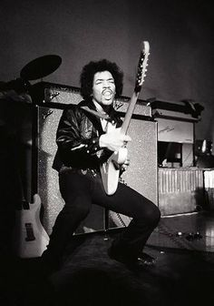 Jimi Hendrix playing in front of some of the coolest Fender Amps ever!