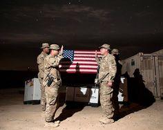 Devil Strike soldier reenlists under the starry Afghanistan sky.