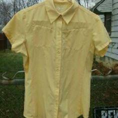 Outdoor shirt Attributes: quick dry, UV protection, antibacterial and vent on back. Soft yellow button up with 2 top zippered pockets. Like new Gander Mountain  Tops Button Down Shirts