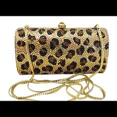 6a49a0ec5fe This Anthony David gold leopard evening bag has a solid metal frame that is  fully covered with Swarovski crystals. Carry it as a clutch handbag or wear  it ...