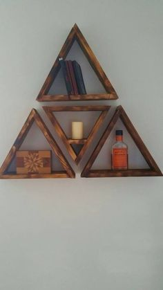 """Reclaimed charred 12"""" triangle shelves with floating insert for any orientation."""