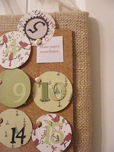 advent calendar - cork board, push pins, scrapbook paper cut into 2 sizes of circles - smaller set with christmas activities or bible verses