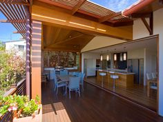 Indoor-outdoor outdoor living design with pergola & latticework fence using timber - Outdoor Living Photo 423573