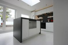 White handleless kitchen in a matt painted finish. By us at KB Store Trade. Mande for an interior designer in London.