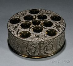 R. Lalique Roger Covered Box. Art glass, France, Marcilhac no. 75, design date 1926. Circular form with etched bird decoration and cabochons from stylized tree branches in smoky glass, marked on base R. Lalique France.
