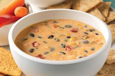 Be sure there's plenty of room around the table before you put out this Spicy Mexican Cheese and Bean Dip. Guests are sure to cluster near it!